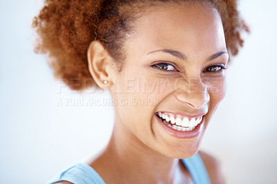 Buy stock photo Closeup portrait of a cheerful young woman smiling