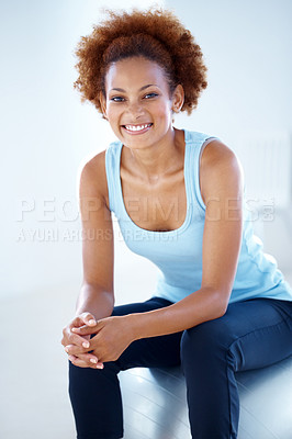 Buy stock photo Portrait of a young female fitness instructor sitting relax on pilates ball