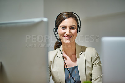 Buy stock photo Portrait of a professional woman using a computer and headset at her desk
