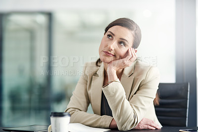 Buy stock photo Shot of a businesswoman looking bored at work