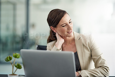 Buy stock photo Shot of a businesswoman suffering from neck pain at her office desk