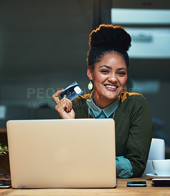 Buy stock photo Portrait of an attractive young woman shopping online while working in the office