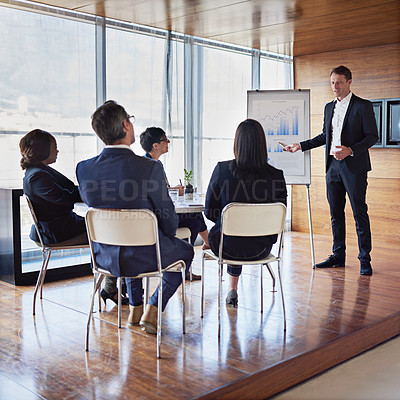 Buy stock photo Shot of a businessman giving a presentation in the boardroom