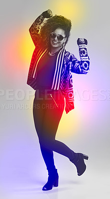 Buy stock photo Portrait of a fashionable young woman dancing in the studio