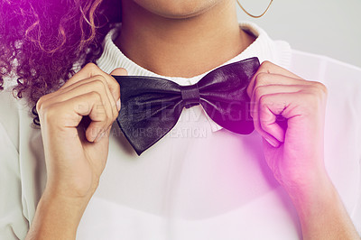 Buy stock photo Cropped shot of a woman wearing a white shirt and a bow tie
