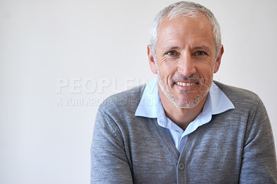 Buy stock photo Cropped portrait of a mature businessman sitting in his office