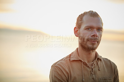 Buy stock photo Portrait of a man spending a relaxing day at the beach