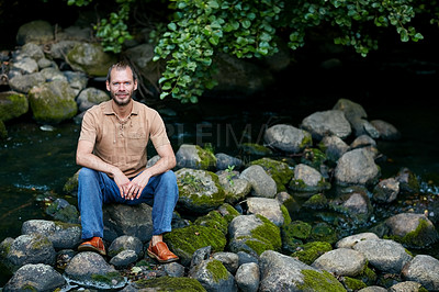 Buy stock photo Portrait of a handsome man sitting outdoors