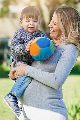 Buy stock photo Cropped shot of a mother bonding with her little boy outside