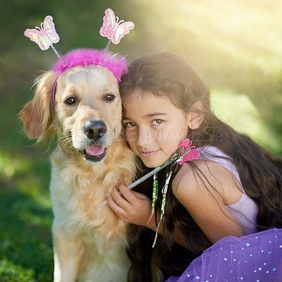 Buy stock photo Portrait of a cute little girl playing dress up with her dog outside