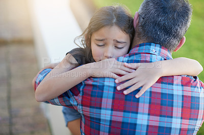 Buy stock photo Shot of a sad little girl being consoled by her father at home