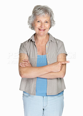 Buy stock photo Portrait of a happy mature woman with her arms crossed isolated against white