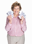 Happy elderly woman holding cash in hands on white background