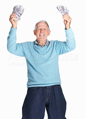 Buy stock photo Portrait of a cheerful senior man holding dollars up in air isolated against white