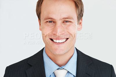 Buy stock photo Portrait of a handsome young businessman in suit smiling at work
