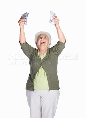 Buy stock photo Portrait of a cheerful mature woman holding dollars and shouting against white