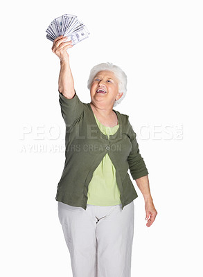 Buy stock photo Portrait of a happy mature woman holding dollars isolated against white