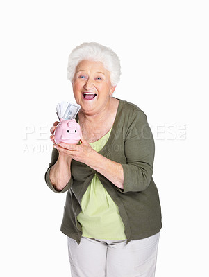 Buy stock photo Portrait of a happy mature woman holding piggy bank isolated against white