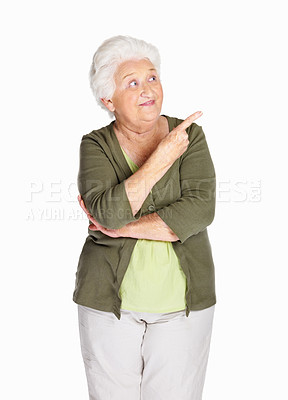 Buy stock photo Portrait of a happy mature woman pointing upward isolated against white