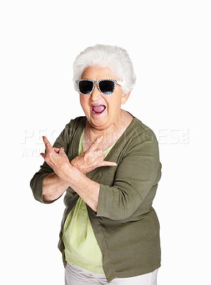 Buy stock photo Portrait of a mature woman wearing sunglasses and doing funky action isolated against white