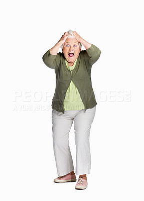 Buy stock photo Portrait of a shocked elderly woman with hands on head isolated against white
