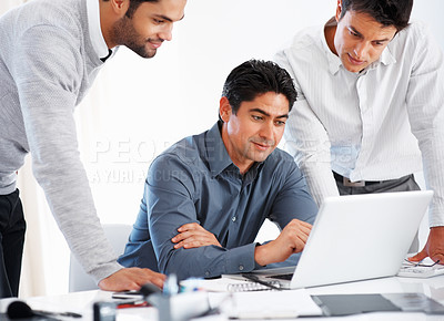 Buy stock photo Three business men preparing presentation on laptop