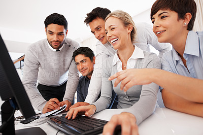 Buy stock photo Smiling business people working on computer during meeting