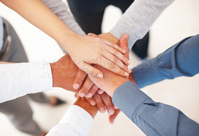 Buy stock photo Group of business people making a pile of hands