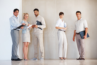 Buy stock photo Full length of successful business people standing together and smiling