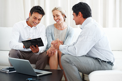 Buy stock photo Business couple in conversation with consultant with man signing insurance contract