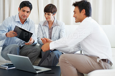 Buy stock photo Attractive couple taking financial advice from consultant