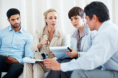 Buy stock photo Colleagues discussing business matters with each other
