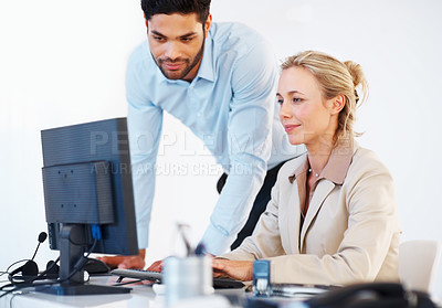 Buy stock photo Two business colleagues working together on computer