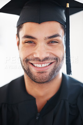Buy stock photo Closeup of young male graduate smiling on white background