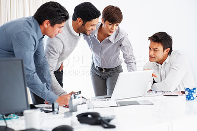 Buy stock photo Leader with his team discussing project on laptop during meeting
