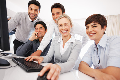 Buy stock photo Group of business people smiling and working together on computer