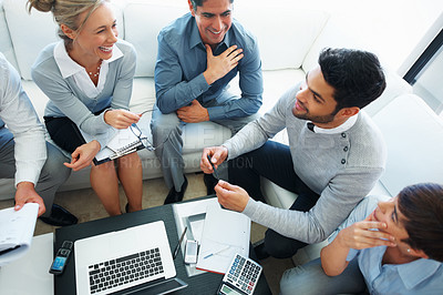 Buy stock photo High angle view of male leader and his team with laptop and documents on table