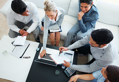 Buy stock photo High angle view of business man discussing project with his colleagues in meeting