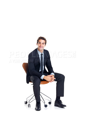 Buy stock photo Happy young male business executive sitting on a chair isolated over white background