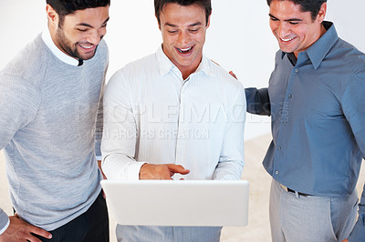 Buy stock photo Male leader with his team working on laptop