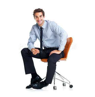 Buy stock photo Handsome young businessman sitting on chair isolated over whiter background