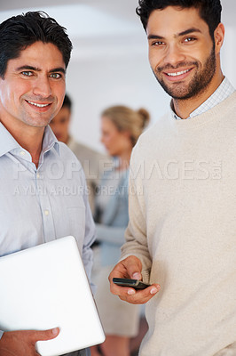 Buy stock photo Portrait of smiling business partners with colleagues in background