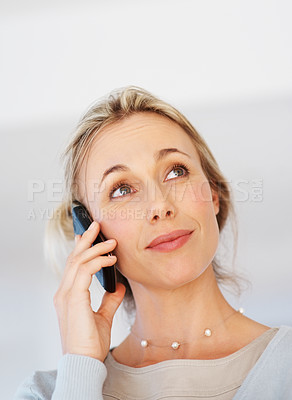 Buy stock photo Closeup of business woman having conversation on cellphone and looking away