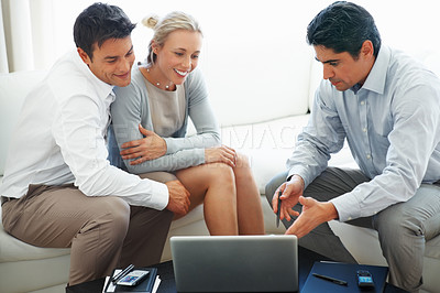 Buy stock photo Consultant explaining financial plans on laptop to business couple