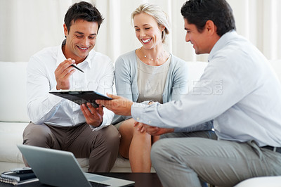 Buy stock photo Business consultant giving new investment plans to happy couple for signing