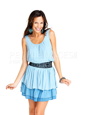 Buy stock photo Portrait of a smiling woman posing sweetly in a casual blue dress, isolated against white background