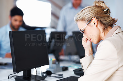 Buy stock photo Business woman in glasses using computer with colleagues working background
