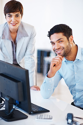 Buy stock photo Portrait of smiling business colleagues working on computer and looking at you