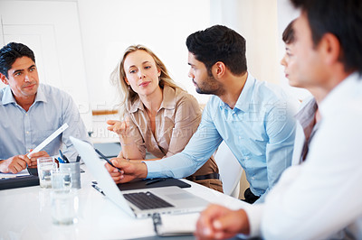 Buy stock photo Female executive in discussion with colleagues during meeting