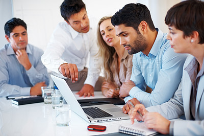Buy stock photo Business man sitting on table and interacting with colleagues during meeting
